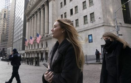 In this Jan. 13, 2021 file photo, people walk by the New York Stock Exchange. Stocks are opening higher on Wall Street as traders welcome some strong reports on the economy including a drop in jobless claims and a big increase in retail spending, as well as more robust earnings …
