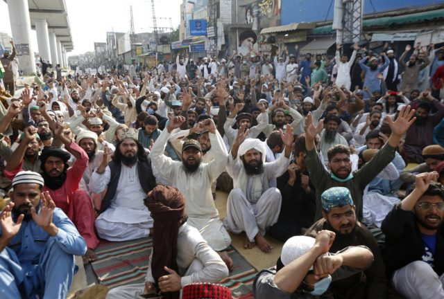 Supporters of Tehreek-e-Labiak Pakistan, a radical Islamist political party, chant slogans during a protest against the arrest of their party leader, Saad Rizvi, in Lahore, Pakistan, Thursday, April 15, 2021. The French embassy in Pakistan on Thursday advised all of its nationals and companies to temporarily leave the country, days …