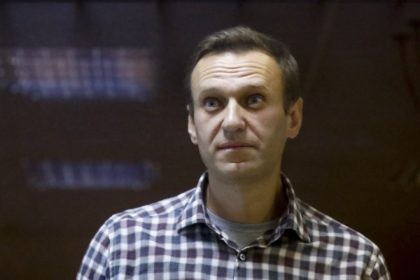 "In this Saturday, Feb. 20, 2021 file photo, Russian opposition leader Alexei Navalny stands in a cage in the Babuskinsky District Court in Moscow, Russia. Imprisoned Russian opposition leader Alexei Navalny, who has been on hunger strike since March 31, described threats to force-feed him, using ""straitjacket and other pleasures,"" …"