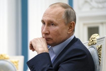 In this Thursday, March 4, 2021 file photo, Russian President Vladimir Putin listens during a meeting with participants of the We Are Together nationwide volunteer campaign in the Kremlin in Moscow, Russia. Hit by a barrage of new sanctions from the Biden administration, the Kremlin is carefully weighing its response …