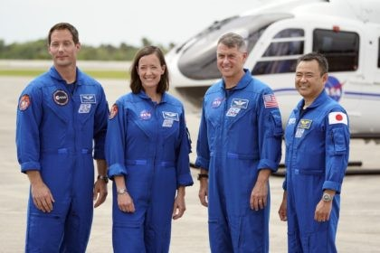 SpaceX Crew 2 members, from left, European Space Agency astronaut Thomas Pesquet, NASA astronauts Megan McArthur and Shane Kimbrough and Japan Aerospace Exploration Agency astronaut Akihiko Hoshide gather at the Kennedy Space Center in Cape Canaveral, Fla., Friday, April 16, 2021 to prepare for a mission to the International Space …