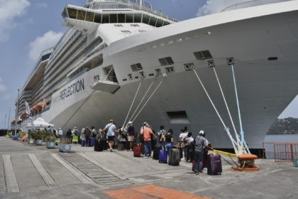 British, Canadian and U.S. nationals line up alongside the Royal Caribbean cruise ship Reflection to be evacuated free of charge, in Kingstown on the eastern Caribbean island of St. Vincent, Friday, April 16, 2021. La Soufriere volcano has shot out another explosive burst of gas and ash Friday morning as …