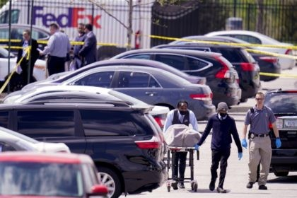 A body is taken from the scene where multiple people were shot at a FedEx Ground facility in Indianapolis, Friday, April 16, 2021. A gunman killed several people and wounded others before taking his own life in a late-night attack at a FedEx facility near the Indianapolis airport, police said. …