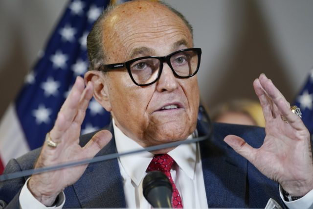 In this Nov. 19, 2020, file photo, former New York Mayor Rudy Giuliani speaks during a news conference at the Republican National Committee headquarters in Washington. Federal agents raided Giuliani's Manhattan home and office on Wednesday, April 28, 2021, seizing computers and cellphones in a major escalation of the Justice …