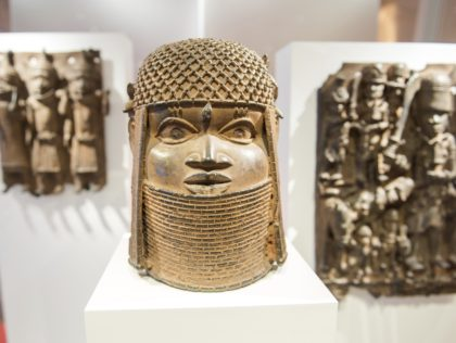 Three pieces of Benin Bronzes are displayed at Museum for Art and Crafts in Hamburg, Germany, Wednesday, Feb. 14, 2018. Germany is returning hundreds of artifacts known as Benin Bronzes that were mostly looted from western Africa by a British colonial expedition and subsequently sold to collections around the world, …