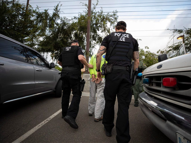 In this July 8, 2019, photo, a U.S. Immigration and Customs Enforcement (ICE) officers escort a man in handcuffs during an operation in Escondido, Calif. The carefully orchestrated arrest last week in this San Diego suburb illustrates how President Donald Trump's pledge to start deporting millions of people in the …