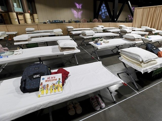 A sleeping area set up inside exhibit hall B of the Long Beach Convention Center, Thursday, April 22, 2021, in Long Beach, Calif., where migrant children found at the U.S.-Mexico border without a parent will be temporarily housed. The beds are in pods of 30. The center is able to …
