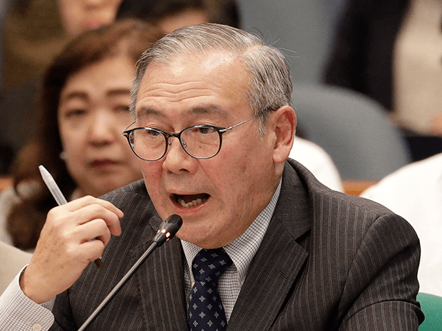 In this Feb. 6, 2020, file photo, Philippine Secretary of Foreign Affairs Teodoro Locsin Jr. gestures during a senate hearing in Manila, Philippines. The Philippine government has protested the Chinese coast guard's harassment of Philippine coast guard ships patrolling a disputed shoal in the South China Sea, the Department of …