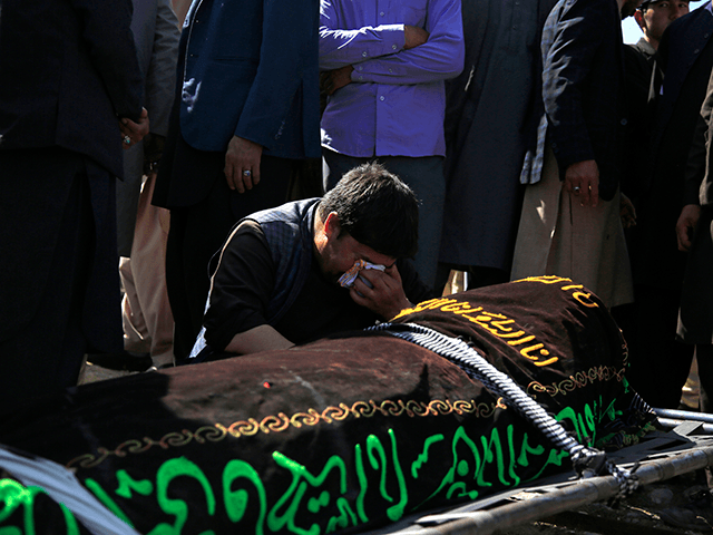 A man cries over the body of a victim of deadly bombings on Saturday near a school, at a cemetery west of Kabul, Afghanistan, Sunday, May 9, 2021. The Interior Ministry said Sunday the death toll in the horrific bombing at the entrance to a girls' school in the Afghan capital has soared to some 50 people, many of them pupils between 11 and 15 years old, and the number of wounded in Saturday's attack has also climbed to more than 100. (AP Photo/Mariam Zuhaib)