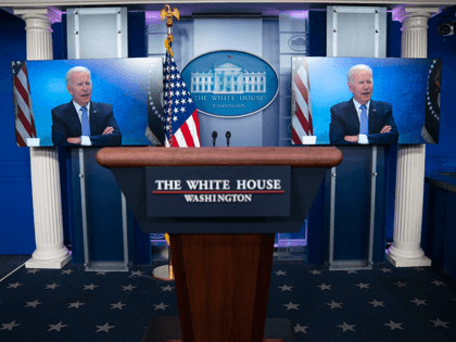 A monitor displays President Joe Biden participating in a virtual meeting with governors about the COVID response, in the briefing room of the White House, Tuesday, May 11, 2021, in Washington. (AP Photo/Evan Vucci)