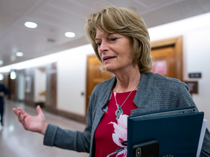 Sen. Lisa Murkowski, R-Alaska, pauses to speak to reporters about the cyberattack on Colonial Pipeline as she leaves a Senate Energy and Natural Resources Committee hearing on Capitol Hill in Washington, Tuesday, May 18, 2021. Murkowski joined Sen. Joe Manchin, D-W.Va., this week in calling on Congress to reauthorize the …