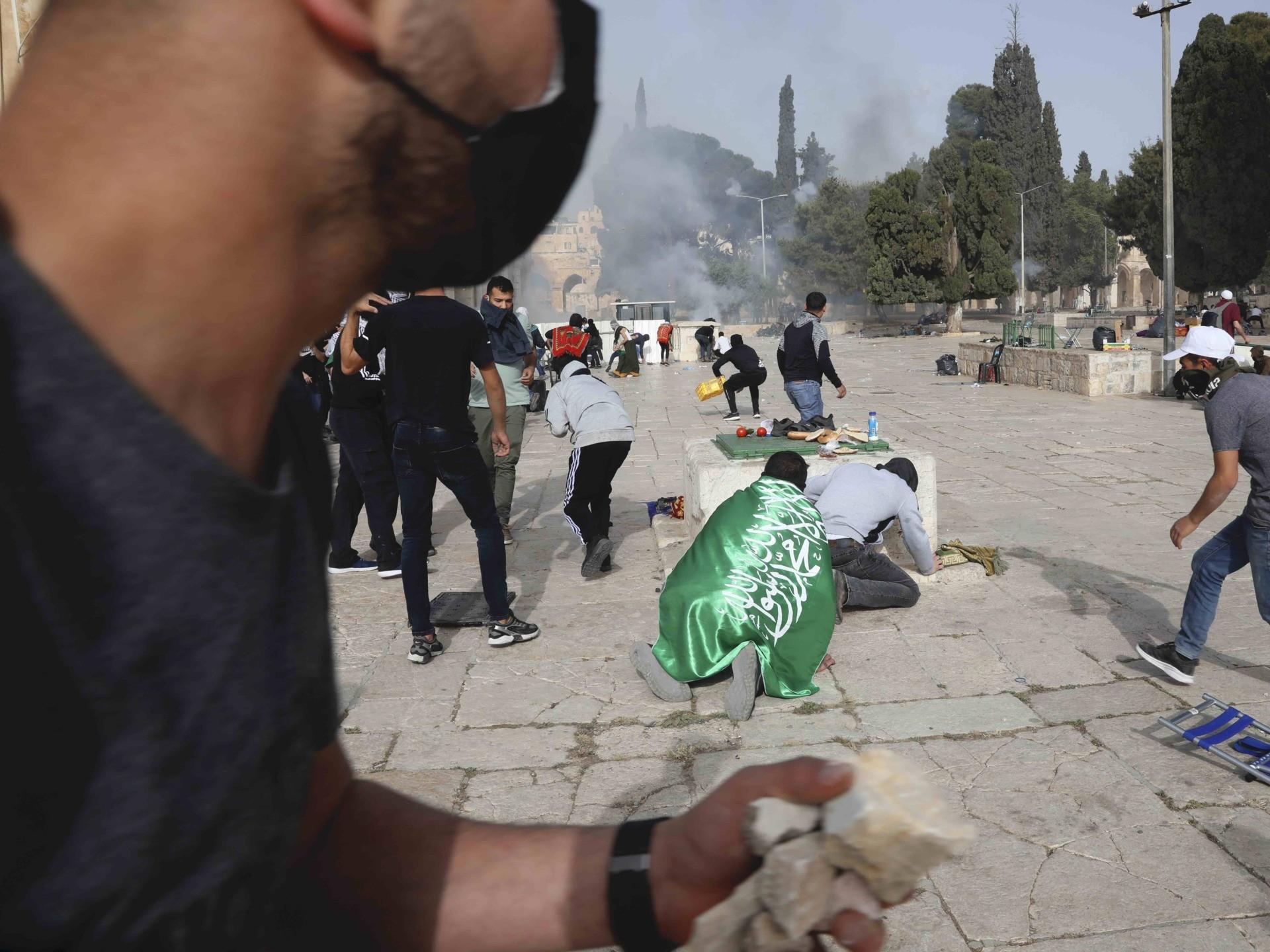 Al Aqsa rocks (Mahmoud Illean / Associated Press)