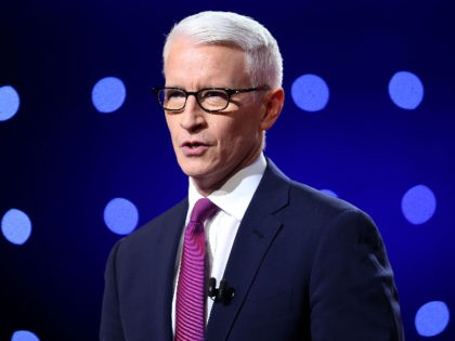 FLINT, MI - MARCH 06: Debate moderator Anderson Cooper looks during the CNN Democratic Presidential Primary Debate between Democratic presidential candidate Hillary Clinton and candidate Senator Bernie Sanders (D-VT) at the Whiting Auditorium at the Cultural Center Campus on March 6, 2016 in Flint, Michigan. Voters in Michigan will go …
