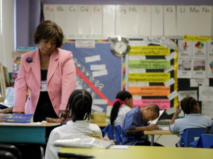 In this March 25, 2010 photo, Experience Corps tutor Elizabeth Dorsey helps a student at Belmont Elementary in Baltimore. Experience Corps operates in 22 cities nationwide and trains volunteers over 55 to tutor and mentor elementary school students. (AP Photo/Rob Carr)