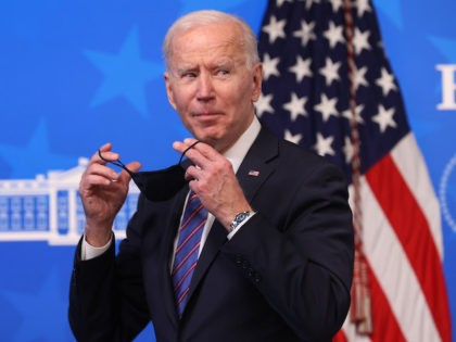 U.S. President Joe Biden replaces his face mask following an Equal Pay Day event in the South Court Auditorium in the Eisenhower Executive Office Building on March 24, 2021 in Washington, DC. Highlighting the gender pay gap, Equal Pay Day raises awareness that women in the United States earned $0.82 …
