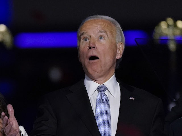 From left, Doug Emhoff, husband of Vice President-elect Kamala Harris, Harris, President-elect Joe Biden and his wife Jill Biden react after confetti was released Saturday, Nov. 7, 2020, in Wilmington, Del. (AP Photo/Andrew Harnik)