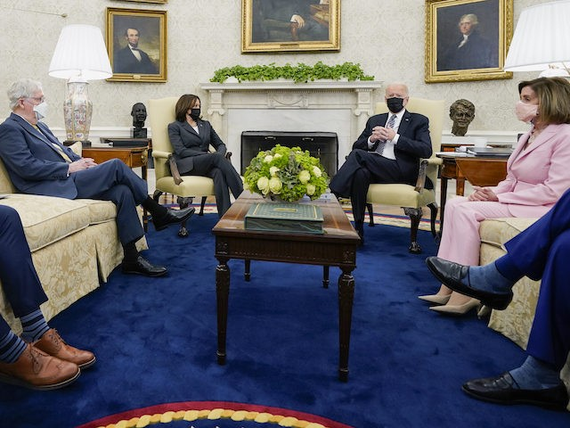 President Joe Biden speaks during a meeting with congressional leaders in the Oval Office of the White House, Wednesday, May 12, 2021, in Washington. From left, House Minority Leader Kevin McCarthy of Calif., Senate Minority Leader Mitch McConnell of Ky., Vice President Kamala, Biden, House Speaker Nancy Pelosi of Calif., …