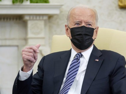 President Joe Biden snaps his fingers as he responds to a reporters question during a meeting with congressional leaders in the Oval Office of the White House, Wednesday, May 12, 2021, in Washington. (AP Photo/Evan Vucci)