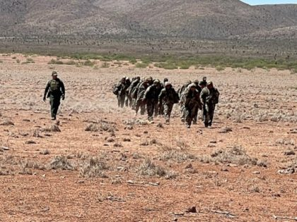 Border Patrol agents apprehend a large group of migrants marching through the Big Bend Sector desert. (Photo: U.S. Border Patrol/Big Bend Sector)