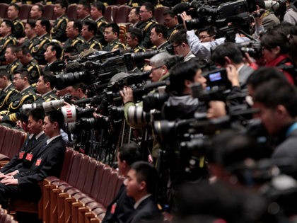 BEIJING, CHINA - MARCH 03: (CHINA OUT) Members of the media work during the opening session of the Chinese People's Political Consultative Conference at the Great Hall of the People on March 3, 2013 in Beijing, China. Over 2,000 members of the 12th National Committee of the Chinese People's Political …