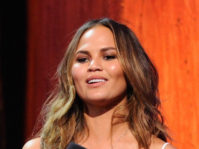 Yassir Lester and Chrissy Teigen speak onstage at the 2014 MTV Upfront, on Thursday, April 24, 2014 at the Beacon Theater in New York. (Photo by Charles Sykes/Invision for MTV/AP Images)