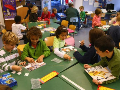 Second-grade children attend class in the elementary school at the John F. Kennedy Schule dual-language public school on September 18, 2008 in Berlin, Germany. The German government will host a summit on education in Germany scheduled for mid-October in Dresden. Germany has consistantly fallen behind in recent years in comparison …