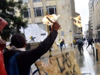BOGOTA, COLOMBIA - MAY 05: A protester throws a molotov cocktail towards riot police at Bolivar Square during national strike on May 05, 2021 in Bogota, Colombia. Despite that the ruling party announced withdrawal of the unpopular bill for a tax reform and the resignation of the Minister of Finances, …
