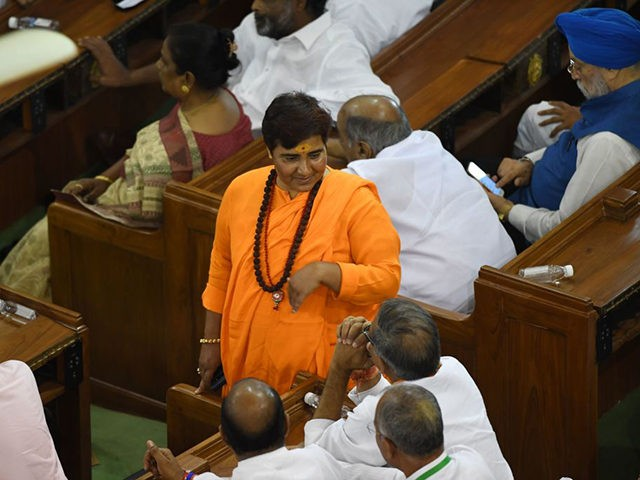 Indian Bharatiya Janata Party (BJP) and newly elected member of parliament for Bhopal constituency Pragya Singh Thakur (C), known as Sadhvi Pragya, attends a National Democratic Alliance (NDA) meeting at the central hall of the parliament, in New Delhi on May 25, 2019. - Modi has been formally elected as …