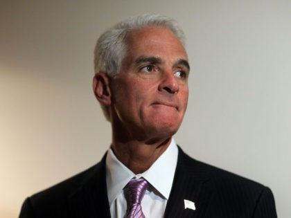 Florida Governor Charlie Crist looks on during a press conference after thanking workers helping Haitian victims of the earthquake in Port-au-Prince transition through the Miami International Airport on February 1, 2010 in Miami, Florida. The Governor spoke about the confusion surrounding some reports that the state of Florida had refused …