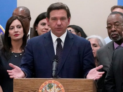 Florida Gov. Ron DeSantis, center, speaks before signing a bill that increases eligibility to attend private schools at public expense, during a ceremony at St. John the Apostle School, Tuesday, May 11, 2021, in Hialeah, Fla. The bill is projected to allow more than 60,000 previously ineligible students to seek …