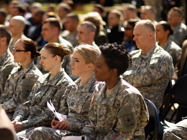 Sergeant Major of the Army Daniel Dailey, Army Secretary John McHugh and Chief of Staff of the Army General Raymond Odierno participate in a commencement ceremony for the U.S. Army's annual observance of Sexual Assault Awareness and Prevention Month in the Pentagon Center Courtyard March 31, 2015 in Arlington, Virginia. …