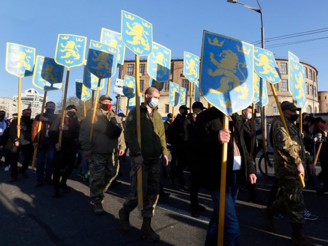Ukrainian nationalists carry emblems of the so-called Galychyna Division during a commemorating march in Kyiv, Ukraine, Wednesday, April 28, 2021. The 14th Waffen Grenadier Division of the SS, called also Galychyna Division, was a World War II German military formation initially made up of volunteers from the region of Galycia …
