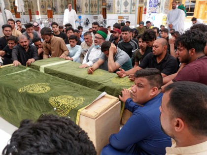 Iraqis mourn relatives killed during a fire in a hospital in the capital, during a funeral procession in the holy shrine city of Najaf, on April 25, 2021. - The fire which erupted pre-dawn at the Ibn Al-Khatib Hospital in Baghdad, a medical facility reserved for the most severe COVID-19 …