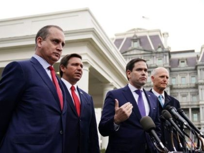 US senators Marco Rubio (C) and Rick Scott (R) along with Representative Mario Diaz-Balart (L) and Florida Governor Ron DeSantis, speak to reporters after a meeting with US President Donald Trump on Venezuela, outside of the West Wing of the White House in Washington, DC on January 22, 2019. (Photo …