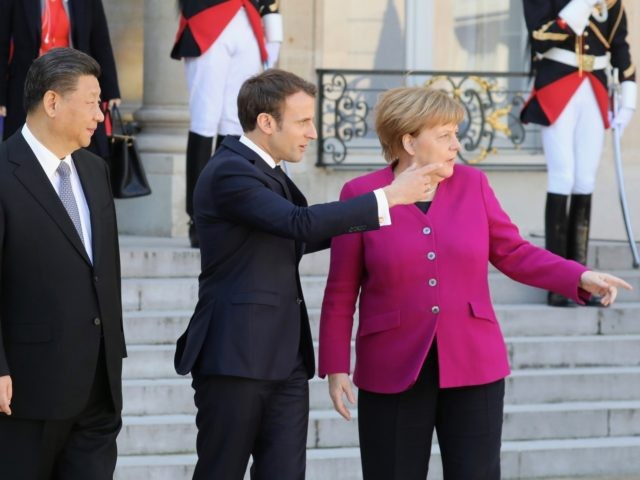 French President Emmanuel Macron (C) speaks with German Chancellor Angela Merkel (R) and Chinese President Xi Jinping (L) following their meeting at the Elysee Palace in Paris on March 26, 2019. - The leaders of China, France, Germany and the EU were set to meet in Paris on March 26 …