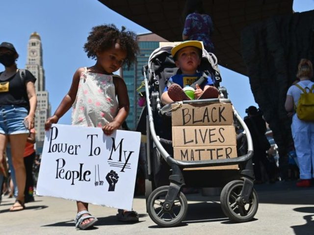 Families participate in a children's march in solidarity with the Black Lives Matter movement and national protests against police brutality on June 9, 2020 in the Brooklyn Borough of New York City. - George Floyd will be laid to rest Tuesday in his Houston hometown, the culmination of a long …