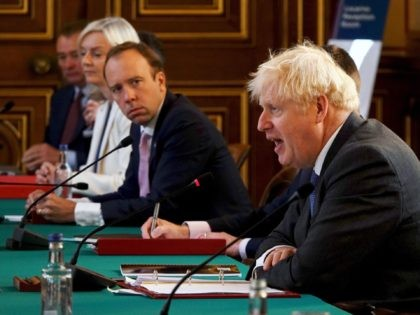 LONDON, ENGLAND - SEPTEMBER 15: British Prime Minister Boris Johnson (R) speaks as Secretary of State for Health and Social Care, Matt Hancock (C) listens during a Cabinet Meeting at the Foreign & Commonwealth Office on September 15, 2020 in London, England. (Photo by Jonathan Buckmaster - WPA Pool/Getty Images)