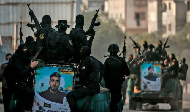 Palestinian Islamic Jihad militants take part in a military rally in Gaza City on November 12, 2020, to mark the first anniversary of the killing of the group's commander Baha Abu Al-Ata in a strike on his home in the Gaza Strip. (Photo by MAHMUD HAMS / AFP) (Photo by …