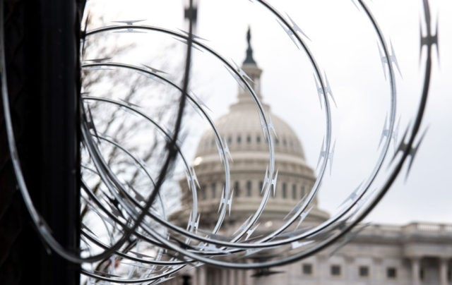 Barbed wire is installed on the top of a security fence surrounding the US Capitol in Washington, DC, January 15, 2021, ahead of next week's presidential inauguration of Joe Biden. (Photo by SAUL LOEB / AFP) (Photo by SAUL LOEB/AFP via Getty Images)