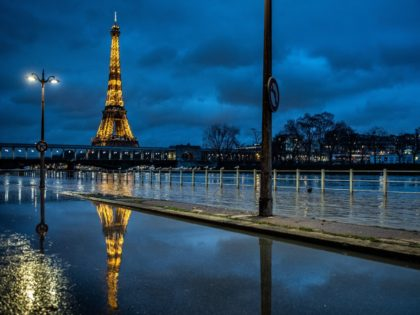 A picture taken on February 1, 2021 in Paris shows the flooded banks of the river Seine with the Eiffel tower in background. (Photo by Martin BUREAU / AFP) (Photo by MARTIN BUREAU/AFP via Getty Images)