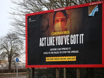 """LONDON, ENGLAND - FEBRUARY 13: A coronavirus billboard near Heathrow Airport on February 13, 2021 in London, England. From 15 February travellers to the UK from a country on the UK's travel ban """"red list"""" will be required to quarantine in a government-approved facility for ten days at their own …"""