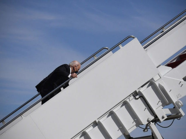 US President Joe Biden trips while boarding Air Force One at Joint Base Andrews in Maryland on March 19, 2021. - President Biden travels to Atlanta, Georgia, to tour the Centers for Disease Control and Prevention, and to meet with Georgia Asian American leaders, following the Atlanta Spa shootings. (Photo …