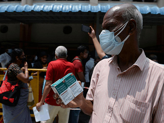 A man holds boxes of Remdesivir, an antiviral drug used to treat Covid-19 coroanavirus symptoms, purchased from government dispensary in Chennai on April 27, 2021. (Photo by Arun SANKAR / AFP) (Photo by ARUN SANKAR/AFP via Getty Images)