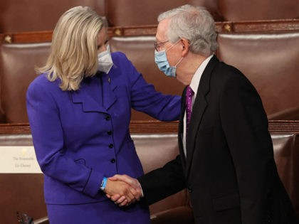 Rep. Liz Cheney, R-Wyo., greets Senate Minority Leader Mitch McConnell of Ky., as they wait for the start of President Joe Biden's first address to a joint session of Congress at the US Capitol in Washington, DC, on April 28, 2021. (Photo by JONATHAN ERNST / POOL / AFP) (Photo …