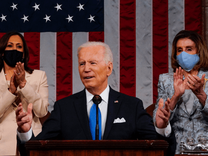 U.S. President Joe Biden addresses a joint session of Congress as Vice President Kamala Harris (L) and Speaker of the House U.S. Rep. Nancy Pelosi (D-CA) (R) look on in the House chamber of the U.S. Capitol April 28, 2021 in Washington, DC. On the eve of his 100th day …