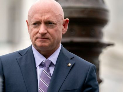 WASHINGTON, DC - APRIL 29: U.S. Sen. Mark Kelly (D-AZ) listens during a news conference outside the U.S. Capitol on April 29, 2021 in Washington, DC. A bipartisan group of Senators gathered in support of the Military Justice Improvement and Increasing Prevention Act, which would move the decision to prosecute …