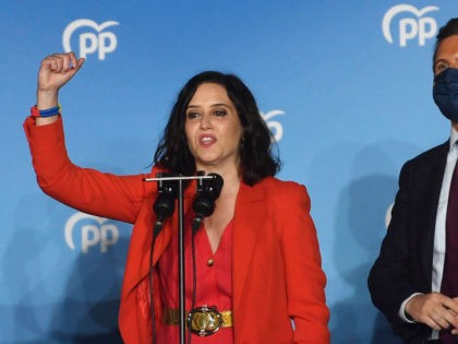 Madrid regional president and People's Party (PP) candidate Isabel Diaz Ayuso (L) delivers a speech as she celebrates her victory in the Madrid regional elections beside PP leader Pablo Casado at the PP headquarters in Madrid on May 4, 2021. - Spain's right-wing People's Party led by rising star Isabel …