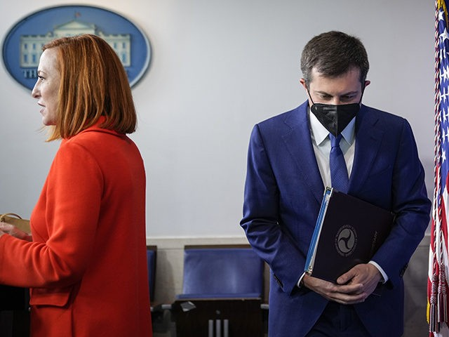 WASHINGTON, DC - MAY 12: (L-R) White House Press Secretary Jen Psaki and Secretary of Transportation Pete Buttigieg arrive for the daily press briefing at the White House on May 12, 2021 in Washington, DC. The majority of the briefing focused on the ransomwareattack on the Colonial Pipeline. More than …