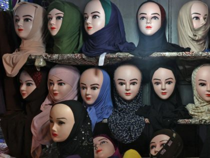A picture taken at a shop in Jerusalem's Old City on May 14, 2021 shows Muslim headdresses, including a nikab full face cover (R). (Photo by Ahmad GHARABLI / AFP) (Photo by AHMAD GHARABLI/AFP via Getty Images)