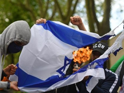Exclusive Video: Pro-Palestinian Protesters Burn Israeli Flag in London